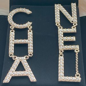 CHANEL Crystal CHA-NEL Logo Earrings